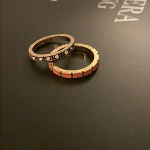 Gold, black, and coral stackable rings